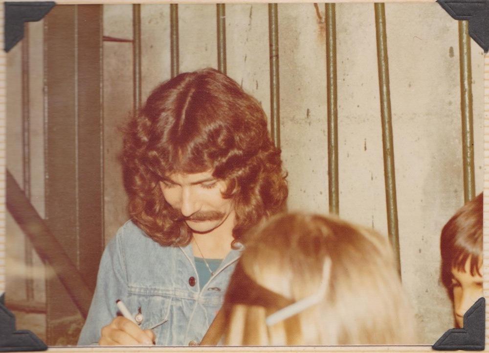 Doug outside signing autographs